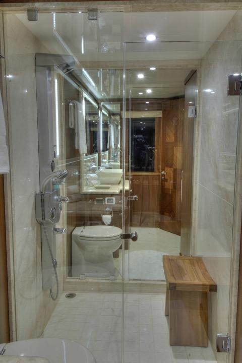 85 Ocean Alexander Master stateroom full beam head w/ walk through shower