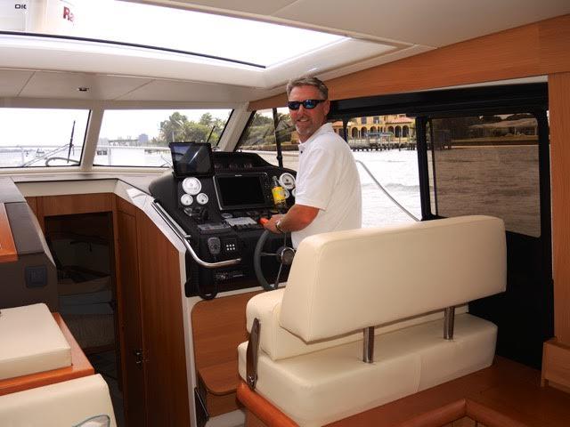 Mike Kiely - captaining boat