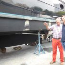 Fl-doing-business-with-dad-Denison Kit Denison, in the red jeans, and his son, Bob Denison, work together at Denison Yacht Sales,  the business formerly owned by Kit and now owned by Bob. Photo: Courtesy/Denison Yacht Sales.
